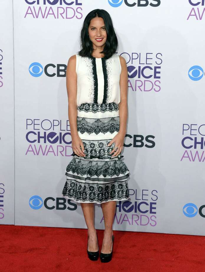 Worst:It's painful to see the beautiful and exotic Olivia Munn emerge from dressing herself in the dark. Kids, pay attention -- never mix vertical and horizontal patterns in the same outfit. It gives people vertigo. Photo: Jason Merritt, Getty Images / 2013 Getty Images
