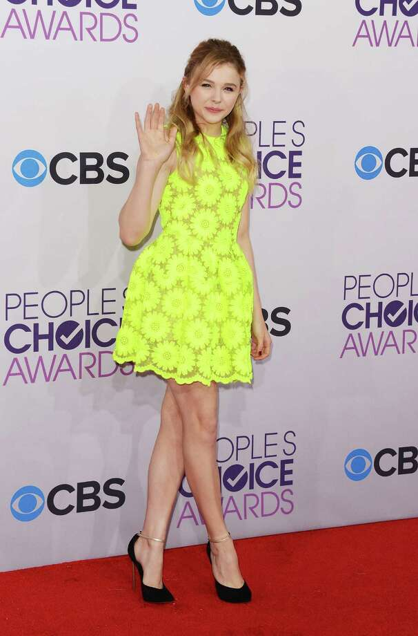 Worst: Chloe Grace Moretz chose a color that should be reserved for road crews working at night, rather than the red carpet. There's no skin tone in the world that can stand up to this retina-burning color. Photo: Jason Merritt, Getty Images / 2013 Getty Images