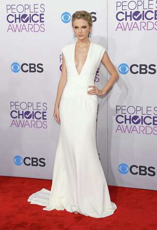 Worst: On its face, there's nothing wrong with Taylor Swift's gown. She's 23 now, so if she wants to explore a plunging neckline and display some cleavage, fine. But nobody does vanilla like Taylor Swift, and even when she tries to take chances it seems like she's playing it safe. She's also a tad overdressed for the occasion. Photo: Jason Merritt, Getty Images / 2013 Getty Images