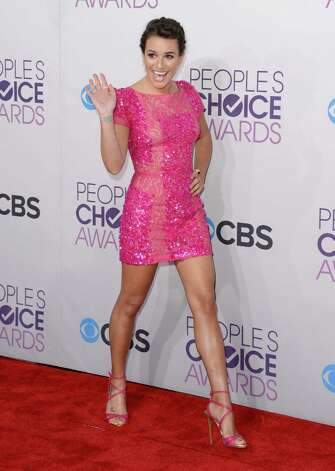 "On the fence: We've come to expect ""Glee"" chanteuse Lea Michele wearing tight and/or revealing clothes on the red carpet, and that's fine -- she's petite, has a good body and wears well-tailored frocks. This dress is no exception, and there are few who could carry this color so well. But what's with the hair? Photo: Jason Merritt, Getty Images / 2013 Getty Images"