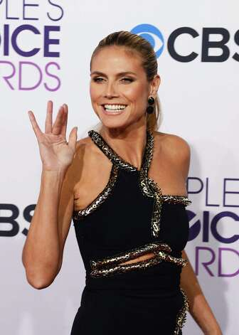 Worst: You don't need to see the full dress on Heidi Klum to know what's wrong with it -- she looks like she's being strangled by snakes. This fashion plate should know better! Photo: Jason Merritt, Getty Images / 2013 Getty Images