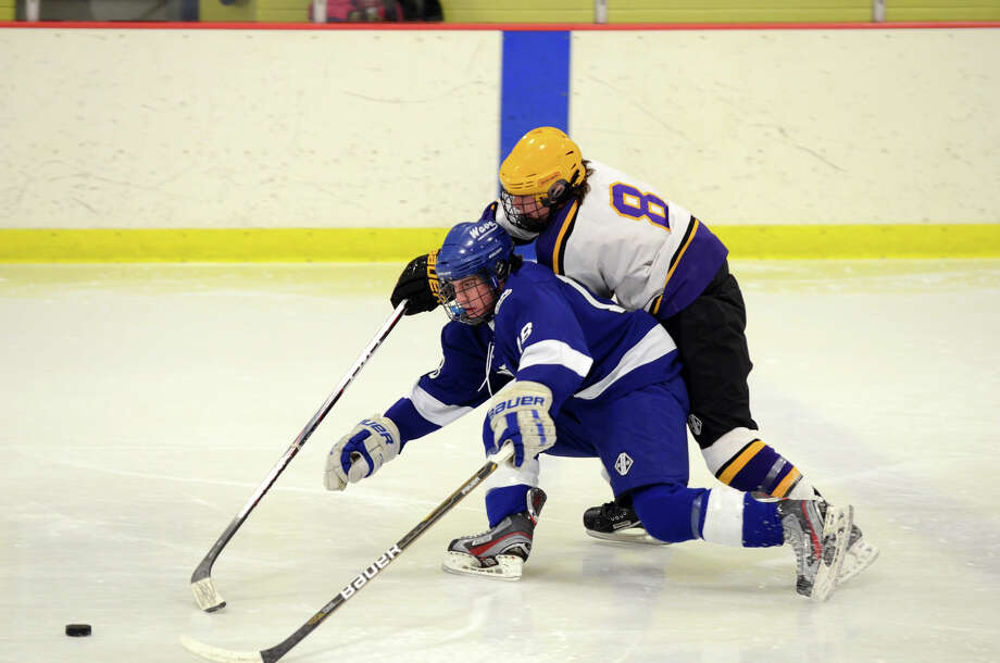 Darien's Kevin Love (18) and Westhill's Ryan Silk (8) go after the puck during the boys hockey game at Terry Connors Rink in Stamford on Wednesday, Jan. 9, 2013. Photo: Amy Mortensen / Connecticut Post Freelance