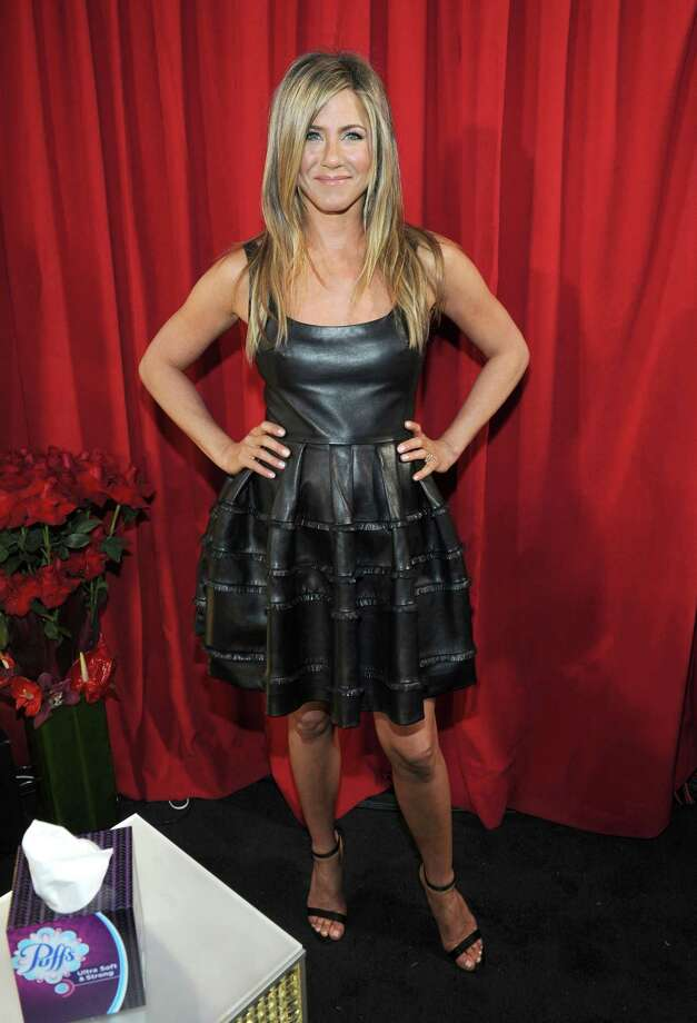 Best: On anyone else this might look like some sort of medieval parody, with the leather and the giant, blocky pleats, but Jennifer Aniston almost never makes a fashion misstep and this is devastatingly youthful for someone who will soon be 44. Photo: Michael Buckner, Getty Images For PCA / 2013 Getty Images