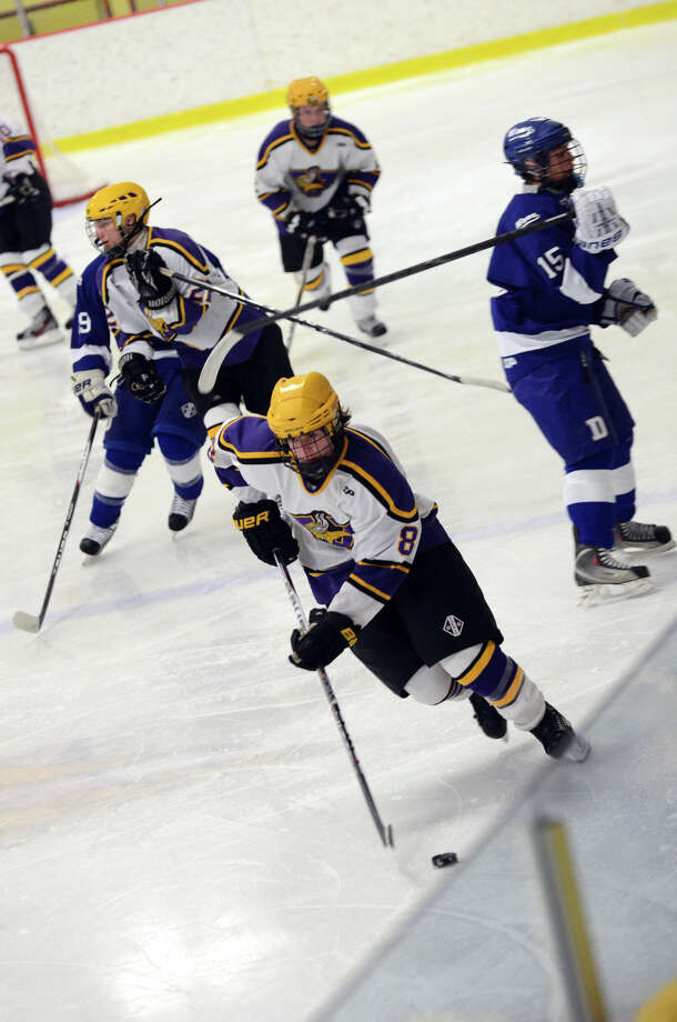 Westhill's Ryan Silk (8) controls the puck during the boys hockey game against Darien High School at Terry Connors Rink in Stamford on Wednesday, Jan. 9, 2013. Photo: Amy Mortensen / Connecticut Post Freelance