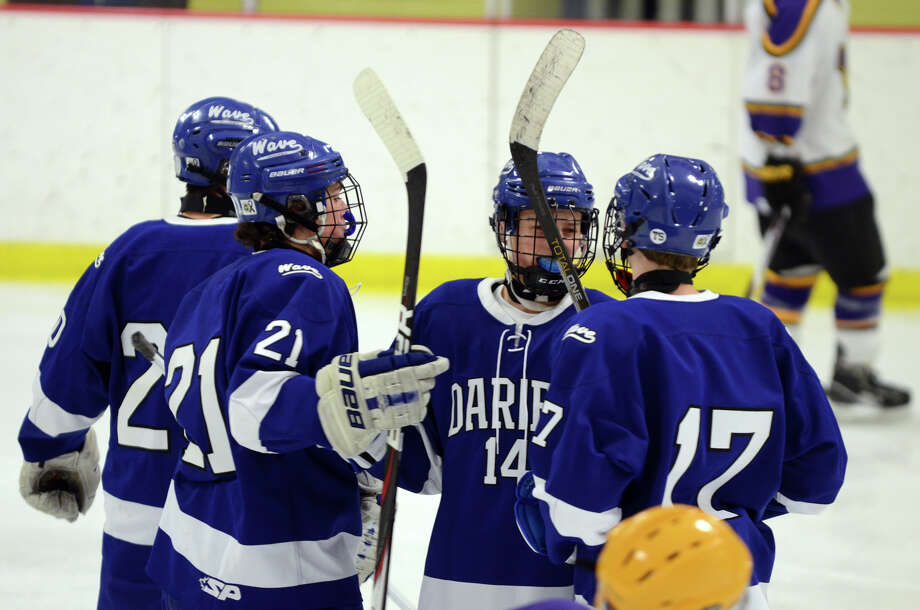 Darien's Brendan Hathaway (21) celebrates a goal with teammates during the boys hockey game against Westhill High School at Terry Connors Rink in Stamford on Wednesday, Jan. 9, 2013. Photo: Amy Mortensen / Connecticut Post Freelance
