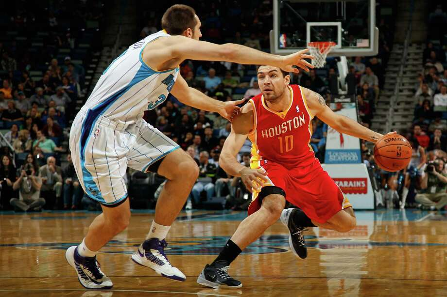 NEW ORLEANS, LA - JANUARY 09:  Carlos Delfino #10 of the Houston Rockets drives the ball around Ryan Anderson #33 of the New Orleans Hornets at New Orleans Arena on January 9, 2013 in New Orleans, Louisiana.  NOTE TO USER: User expressly acknowledges and agrees that, by downloading and or using this photograph, User is consenting to the terms and conditions of the Getty Images License Agreement.  (Photo by Chris Graythen/Getty Images) Photo: Chris Graythen, Staff / 2013 Getty Images