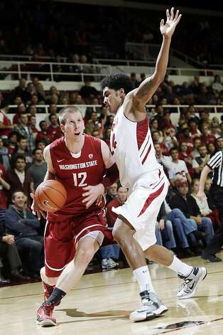 Washington State's Brock Motum (12) is defended by Stanford's Josh Huestis during the first half of an NCAA college basketball game in Stanford, Calif., Wednesday, Jan. 9, 2013. (AP Photo/Marcio Jose Sanchez) Photo: Marcio Jose Sanchez, Associated Press