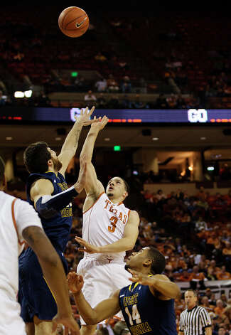 Texas' Javan Felix (3) shoots against West Virginia during the first half of their NCAA college basketball game, Wednesday, Jan. 9, 2013, in Austin, Texas. Photo: Alberto Martinez, AP Photo / Statesman.com / Statesman.com