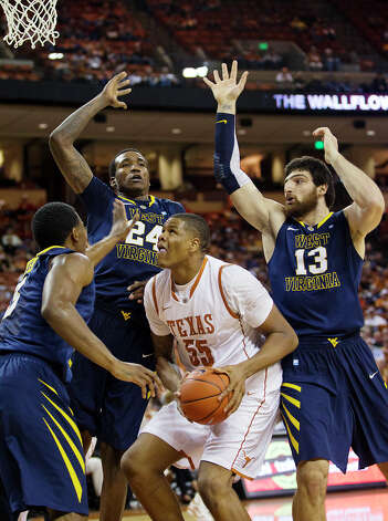 Texas' Cameron Riley (55) is pressured by West Virginia's Aaric Murray (24) and Deniz Kilicli (13) as he tries to shoot during the first half of their NCAA college basketball game, Wednesday, Jan. 9, 2013, in Austin, Texas. Photo: Alberto Martinez, AP Photo / Statesman.com / Statesman.com