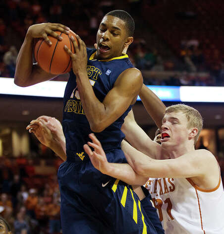 West Virginia's Terry Henderson (15) grabs a rebound against Texas' Connor Lammert during the first half of their NCAA college basketball game, Wednesday, Jan. 9, 2013, in Austin, Texas. Photo: Alberto Martinez, AP Photo / Statesman.com / Statesman.com