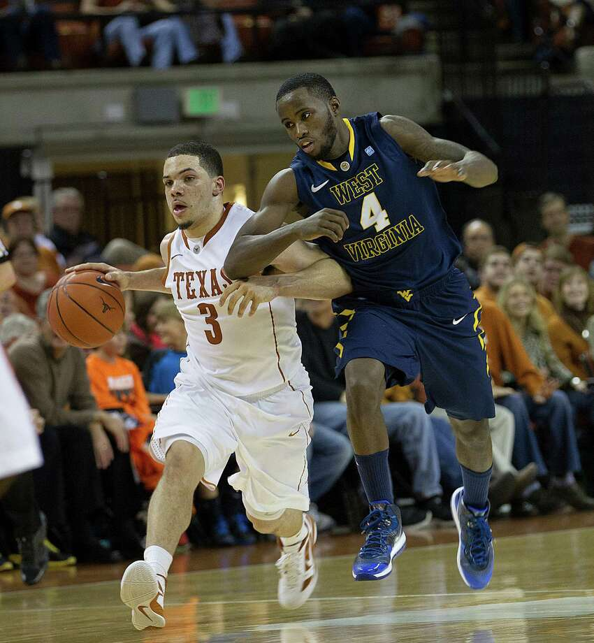 Texas' Javan Felix (3) gets a little elbow action from West Virginia's Jabarie Hinds in the first half at the Erwin Special Events Center in Austin, Texas, on Wednesday, January 9, 2013. (Alberto Martinez/Austin American-Statesman/MCT) Photo: Alberto Martinez, McClatchy-Tribune News Service / Austin American-Statesman