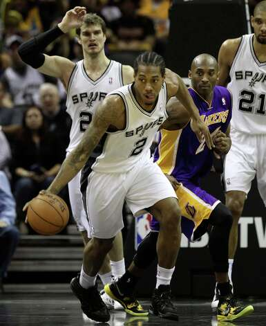 Spurs' Kawhi Leonard (02) steals the ball from Los Angeles Lakers' Kobe Bryant (24) in the first half at the AT&T Center on Wednesday, Jan. 9, 2013. Photo: Kin Man Hui, San Antonio Express-News / © 2012 San Antonio Express-News