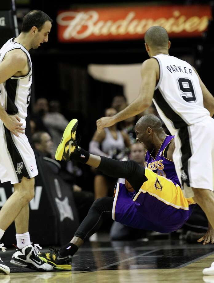 Spurs' Manu Ginobili (20) hip-checks Los Angeles Lakers' Kobe Bryant (24) in the first half at the AT&T Center on Wednesday, Jan. 9, 2013. Photo: Kin Man Hui, San Antonio Express-News / © 2012 San Antonio Express-News