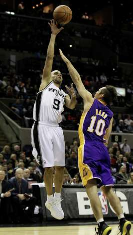 Spurs' Tony Parker (09) shoots over Los Angeles Lakers' Steve Nash (10) in the first half at the AT&T Center on Wednesday, Jan. 9, 2013. Photo: Kin Man Hui, San Antonio Express-News / © 2012 San Antonio Express-News