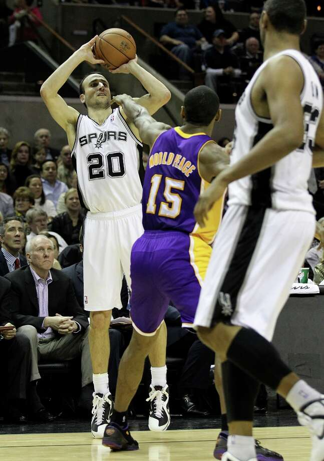 Spurs' Manu Ginobili (20) attempts a three-pointer against Los Angeles Lakers' Metta World Peace (15) in the first half at the AT&T Center on Wednesday, Jan. 9, 2013. Photo: Kin Man Hui, San Antonio Express-News / © 2012 San Antonio Express-News