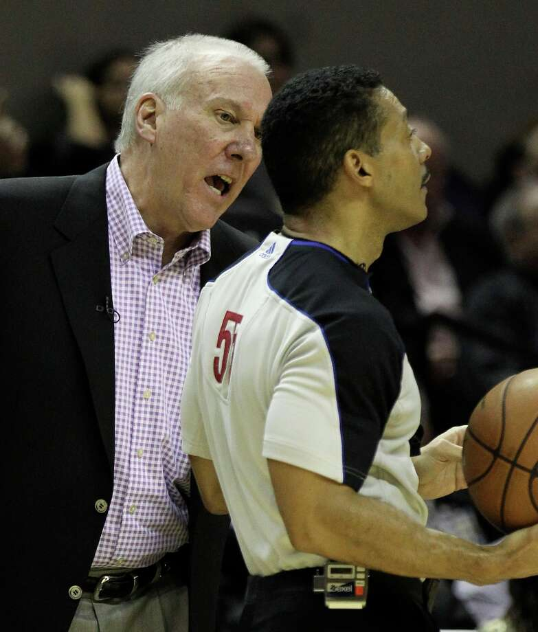 Spurs coach Gregg Popovich questions game official Bill Kennedy during the game against the Los Angeles Lakers in the first half at the AT&T Center on Wednesday, Jan. 9, 2013. Photo: Kin Man Hui, San Antonio Express-News / © 2012 San Antonio Express-News