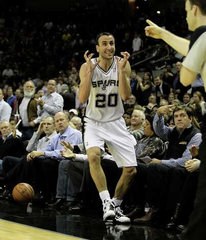 Spurs' Manu Ginobili (20) reacts after attempting a steal against the Los Angeles Lakers in the first half at the AT&T Center on Wednesday, Jan. 9, 2013. Photo: Kin Man Hui, San Antonio Express-News / © 2012 San Antonio Express-News
