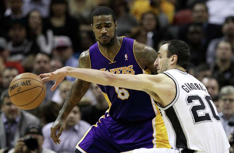 Spurs' Manu Ginobili (20) loses control of the ball while guarded by Los Angeles Lakers' Earl Clark (06) in the second half at the AT&T Center on Wednesday, Jan. 9, 2013. Spurs defeated the Lakers, 108-105. Photo: Kin Man Hui, San Antonio Express-News / © 2012 San Antonio Express-News