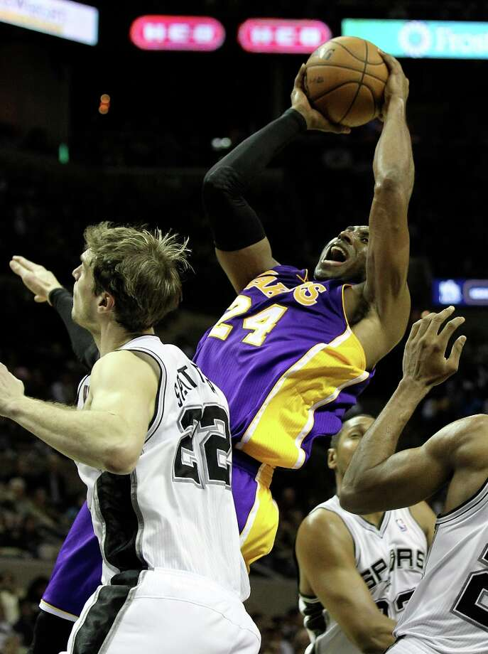 Los Angeles Lakers' Kobe Bryant (24) shoots over Spurs' Tiago Splitter (22) in the second half at the AT&T Center on Wednesday, Jan. 9, 2013. Spurs defeated the Lakers, 108-105. Photo: Kin Man Hui, San Antonio Express-News / © 2012 San Antonio Express-News