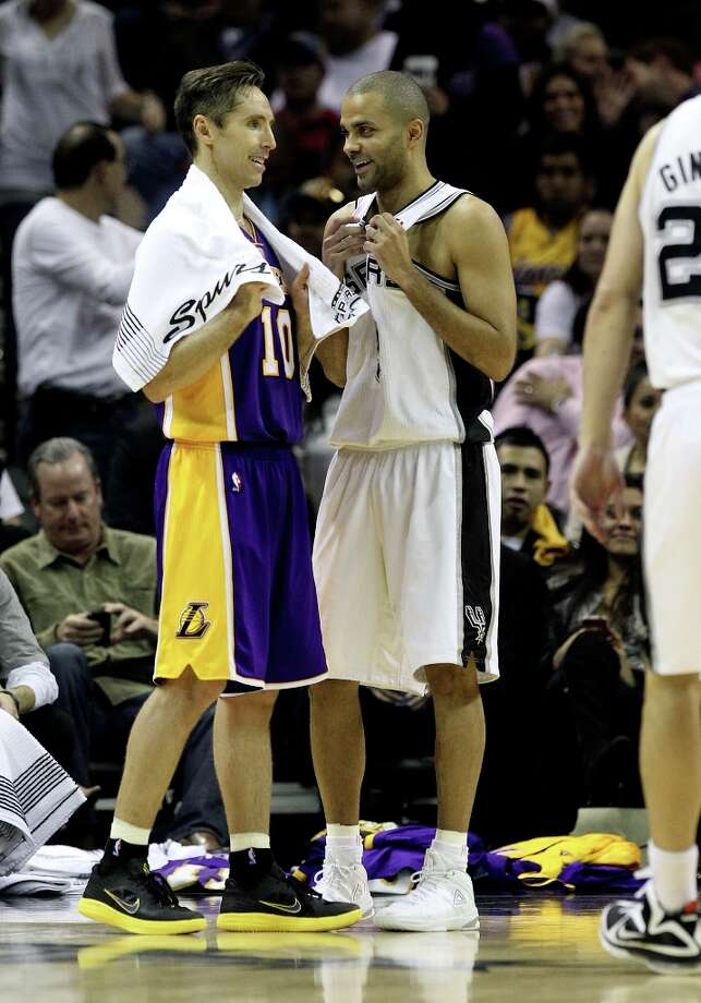 Spurs' Tony Parker (09) and Los Angeles Lakers' Steve Nash (10) chat during a delay in the game in the second half at the AT&T Center on Wednesday, Jan. 9, 2013. Spurs defeated the Lakers, 108-105. Photo: Kin Man Hui, San Antonio Express-News / © 2012 San Antonio Express-News