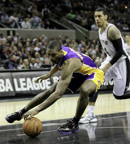 Los Angeles Lakers' Metta World Peace (15) retrieves a loose ball against Spurs' Danny Green (04) in the second half at the AT&T Center on Wednesday, Jan. 9, 2013. Spurs defeated the Lakers, 108-105. Photo: Kin Man Hui, San Antonio Express-News / © 2012 San Antonio Express-News