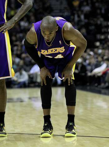 Los Angeles Lakers' Kobe Bryant (24) catches his breath in the second half at the AT&T Center on Wednesday, Jan. 9, 2013. Spurs defeated the Lakers, 108-105. Photo: Kin Man Hui, San Antonio Express-News / © 2012 San Antonio Express-News
