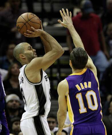 Spurs' Tony Parker (09) attempts a shot against Los Angeles Lakers' Steve Nash (10) in the second half at the AT&T Center on Wednesday, Jan. 9, 2013. Spurs defeated the Lakers, 108-105. Photo: Kin Man Hui, San Antonio Express-News / © 2012 San Antonio Express-News