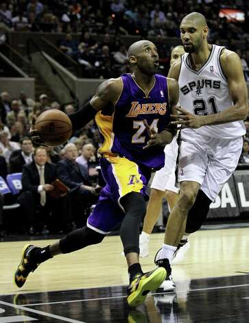 Los Angeles Lakers' Kobe Bryant (24) drives to the basket against Spurs' Tim Duncan (21) in the second half at the AT&T Center on Wednesday, Jan. 9, 2013. Spurs defeated the Lakers, 108-105. Photo: Kin Man Hui, San Antonio Express-News / © 2012 San Antonio Express-News