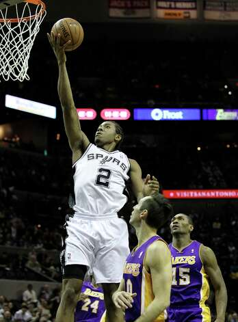 Spurs' Kawhi Leonard (02) lays up a shot against Los Angeles Lakers' Steve Nash (10) in the first half at the AT&T Center on Wednesday, Jan. 9, 2013. Photo: Kin Man Hui, San Antonio Express-News / © 2012 San Antonio Express-News