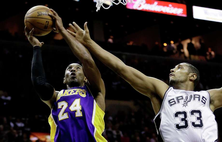 Los Angeles Lakers' Kobe Bryant (24) pulls down a rebound in front of San Antonio Spurs' Boris Diaw (33), of France, during the first quarter of an NBA basketball game on Wednesday, Jan. 9, 2013, in San Antonio. Photo: Eric Gay, Associated Press / AP