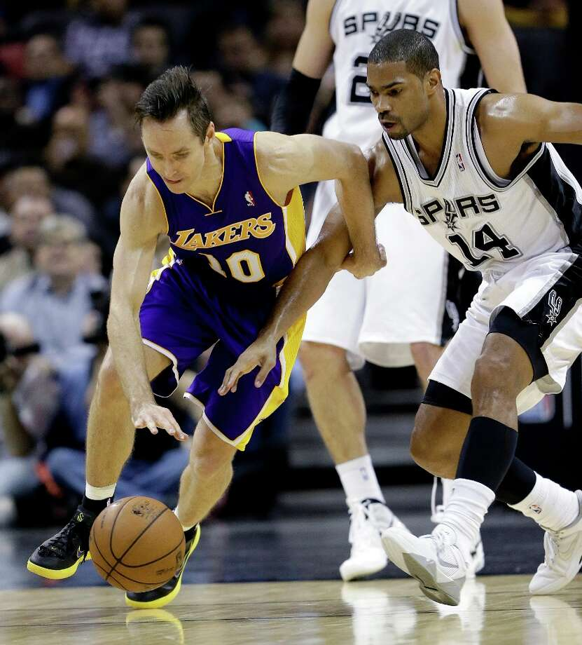 Los Angeles Lakers' Steve Nash, left, and San Antonio Spurs' Gary Neal (14) chase a loose ball during the second quarter of an NBA basketball game on Wednesday, Jan. 9, 2013, in San Antonio. Photo: Eric Gay, Associated Press / AP