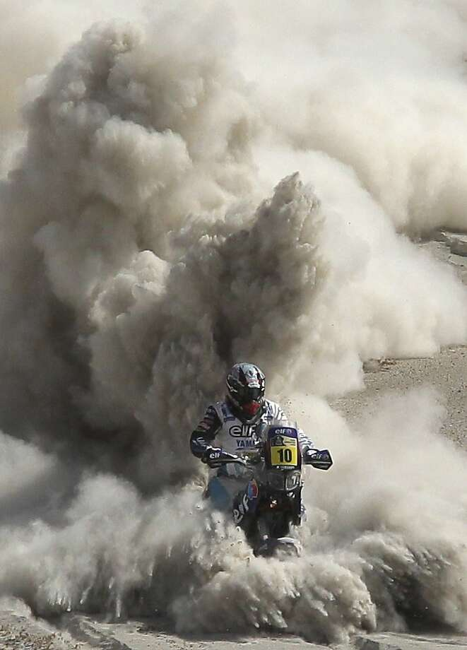Sand blaster:Yamaha rider David Casteu of France throttles through a stretch of fesh-fesh - very fine sand - during the fifth stage of the Dakar Rally from Arequipa, Peru, to Arica, Chile. Photo: Victor R. Caivano, Associated Press