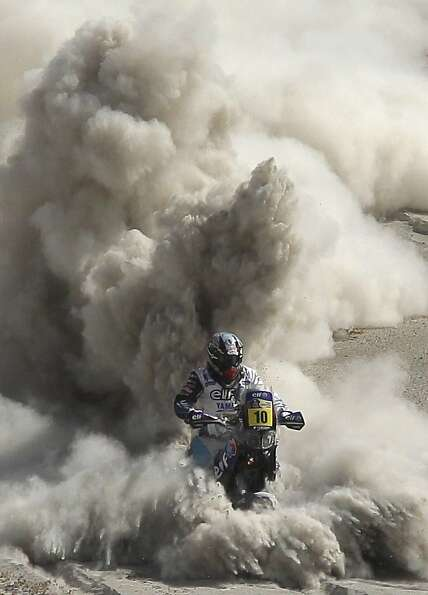 Sand blaster: Yamaha rider David Casteu of France throttles through a stretch of fesh-fesh -