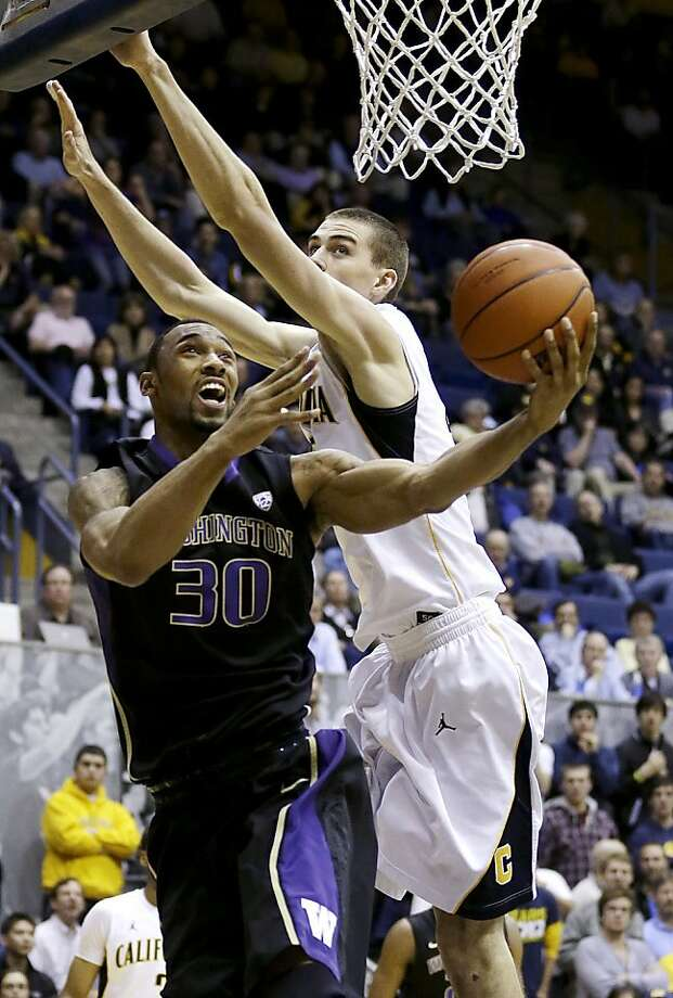 Washington forward Desmond Simmons (30) shoots against California forward David Kravish (45) during the first half of an NCAA college basketball game in Berkeley, Calif., Wednesday, Jan. 9, 2013. (AP Photo/Jeff Chiu) Photo: Jeff Chiu, Associated Press