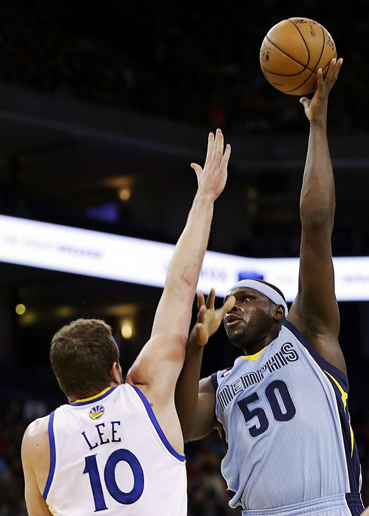 Memphis Grizzlies' Zach Randolph (50) shoots over Golden State Warriors' David Lee during the first half of an NBA basketball game, Wednesday, Jan. 9, 2013, in Oakland, Calif. (AP Photo/Ben Margot)