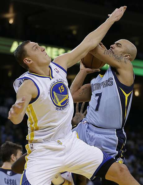Memphis Grizzlies' Jerryd Bayless, right, shoots against Golden State Warriors' Andris Biedrins duri