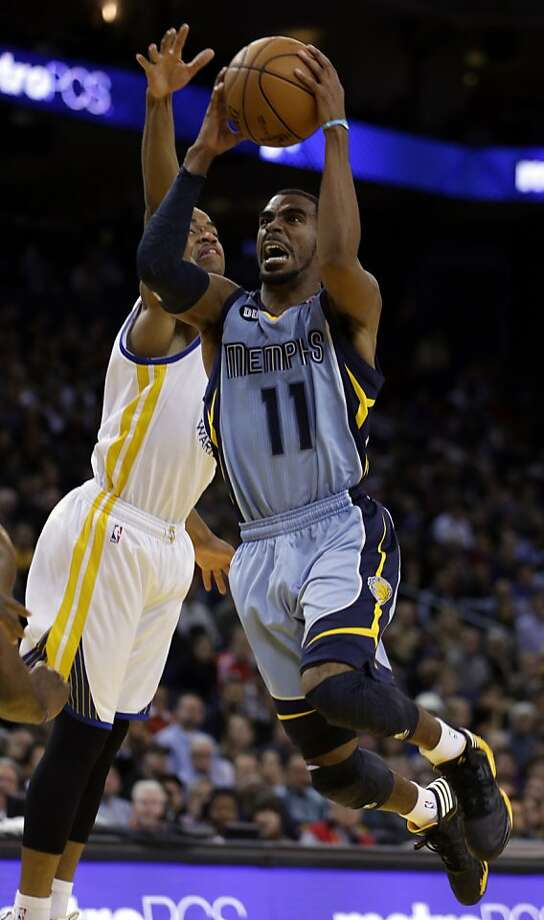 Memphis Grizzlies' Mike Conley, right, shoots against Golden State Warriors' Jarrett Jack during the second half of an NBA basketball game Wednesday, Jan. 9, 2013, in Oakland, Calif. (AP Photo/Ben Margot) Photo: Ben Margot, Associated Press