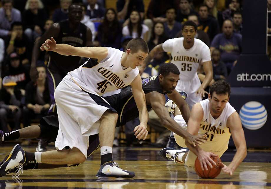 California forward David Kravish (45) and guard Jeff Powers (21) scramble to take the ball away from Wasgington guard Scott Suggs in the second half during an NCAA basketball game against Washington Wednesday Jan 9, 1013, in Berkeley California. Photo: Lance Iversen, The Chronicle