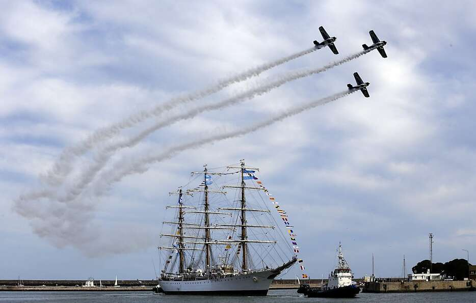 Argentina's naval training tall ship ARA Libertad arrives to port as planes fly overhead during a ce