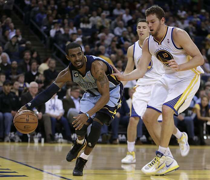 Memphis Grizzlies' Mike Conley, left, drives the ball past Golden State Warriors' David Lee during t