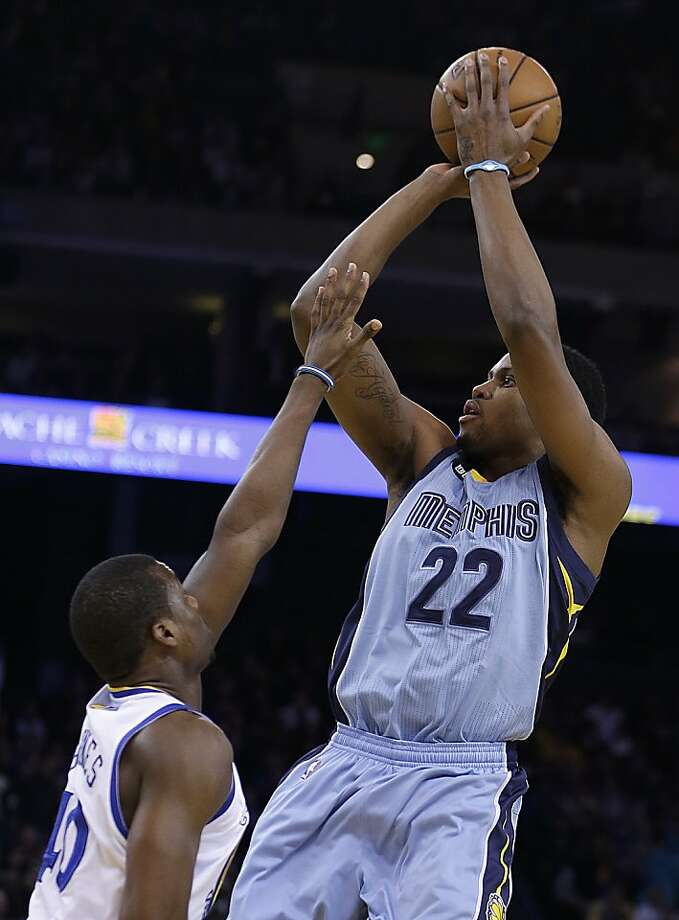 Memphis Grizzlies' Rudy Gay (22) shoots over Golden State Warriors' Harrison Barnes during the first half of an NBA basketball game Wednesday, Jan. 9, 2013, in Oakland, Calif. (AP Photo/Ben Margot) Photo: Ben Margot, Associated Press