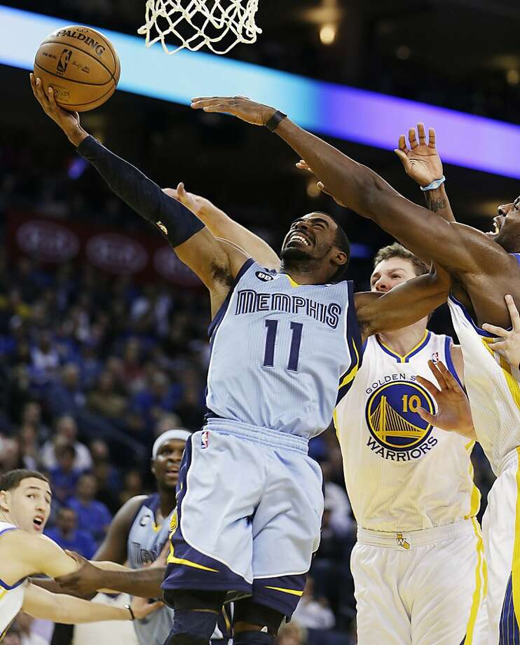 Memphis Grizzlies' Mike Conley (11) shoots against Golden State Warriors' David Lee (10) during the first half of an NBA basketball game, Wednesday, Jan. 9, 2013, in Oakland, Calif. (AP Photo/Ben Margot) Photo: Ben Margot, Associated Press