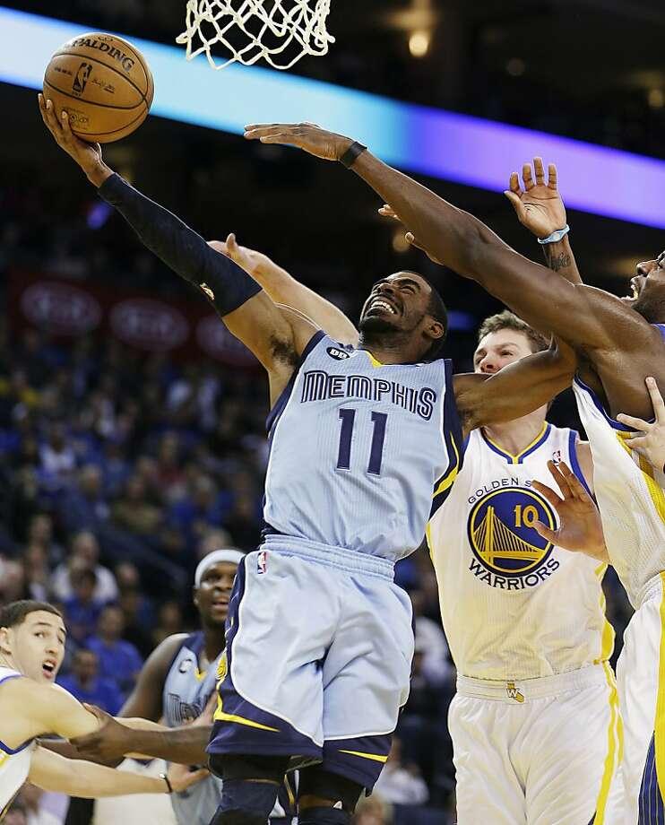 Memphis Grizzlies' Mike Conley (11) shoots against Golden State Warriors' David Lee (10) during the first half of an NBA basketball game, Wednesday, Jan. 9, 2013, in Oakland, Calif. (AP Photo/Ben Margot) Photo: Ben Margot, Associated Press