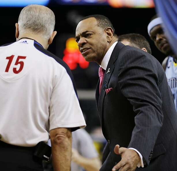 Memphis Grizzlies coach Lionel Hollins, right, speaks with referee Bennett Salvatore (15) during the