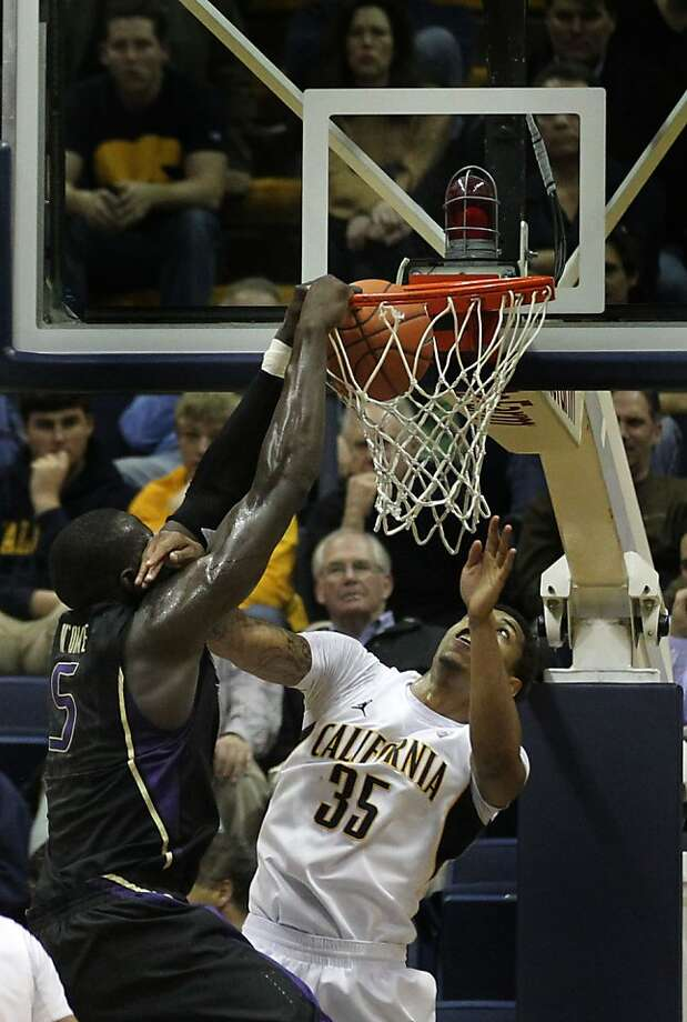 Washington center Aziz N' Diaye scores in front of California forward  Richard Solomon (35) in the first half during an NCAA basketball game against Washington Wednesday Jan 9, 1013, in Berkeley California.  Washington won 62-47 Photo: Lance Iversen, The Chronicle
