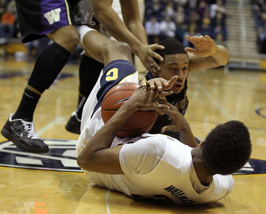 California guard Tyrone Wallace (3) fights for control of the ball with Washington guart Abdul Gaddy (0) in the first half during an NCAA basketball game against Washington Wednesday Jan 9, 1013, in Berkeley California. Photo: Lance Iversen, The Chronicle