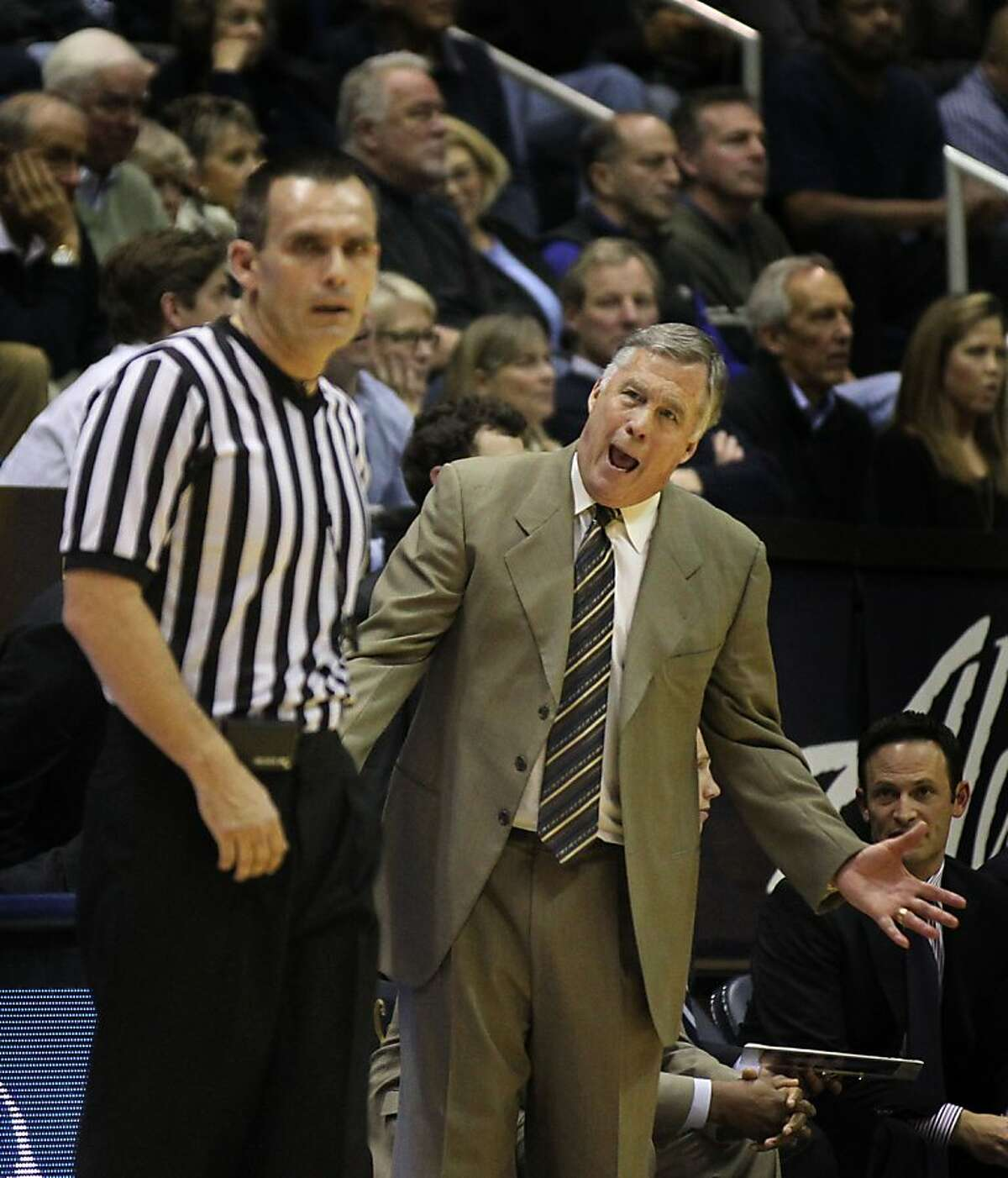 California head coach Mike Montgomery talks with one of the game officials in the first half during an NCAA basketball game against Washington Wednesday Jan 9, 2013, in Berkeley California.