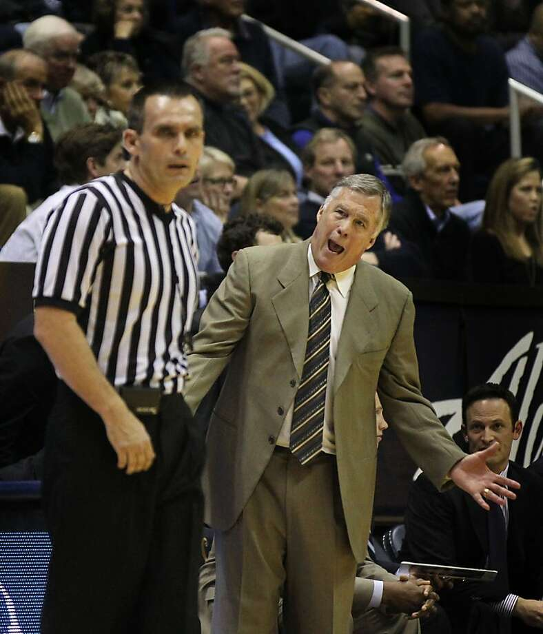 California head coach Mike Montgomery talks with one of the game officials in the first half during an NCAA basketball game against Washington Wednesday Jan 9, 2013, in Berkeley California. Photo: Lance Iversen, The Chronicle