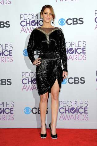 Jennifer Lawrence, wearing Valentino, poses backstage at the People's Choice Awards at the Nokia Theatre on Wednesday Jan. 9, 2013, in Los Angeles. Photo: Jordan Strauss/Invision/AP