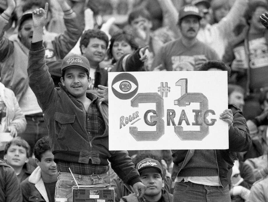 Dec. 22, 1985: San Francisco 49ers fans hold up a sign supporting Roger Craig during a game against the Dallas Cowboys. The multi-talented running back set a rushing/receiving mark midway through the game. Photo: Tom Levy, The Chronicle / ONLINE_YES